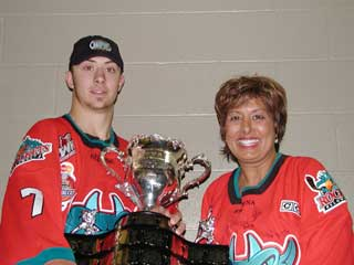 MLA Sindi Hawkins holds the Memorial Cup  with Rockets captain Josh Gorges. (Photo: Wayne Moore)