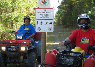 No unauthorized vehicles. ATV riders say they're not   welcome on Kelowna's Kettle Valley   Railway. Photo gallery included.