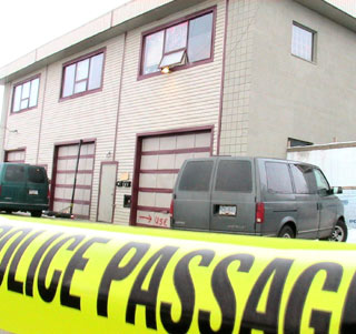 RCMP say this Vernon warehouse being  searched in connection with the  disappearance of two men, has links  to the Hells Angels.