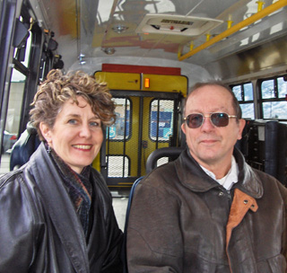 Kim Lyster and Councilor Randy Manuel take a ride on the new handyDart bus. (Photo: Contributed)