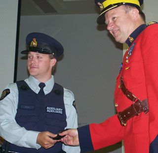 RCMP Superintendent, Bill McKinnon welcomes one of more than 50 Auxiliary Officers to duty. (File Photo: Wayne Moore - Castanet)