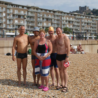 Brent Hobbs (far right) on the beaches of Dover, England. (Photo: Brent Hobbs' blog)
