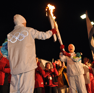 The flame is passed at the West Kelowna celebration. (Photo by Elisha Dacey)
