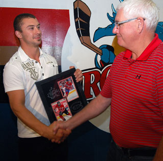 Rockets owner Bruce Hamilton congratulates Josh Gorges following Thursday's brief ceremony. (Photo: Wayne Moore - Castanet)