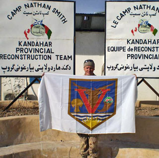 L.S. Eley with the Vernon flag in Afghanistan. (Photo: Contributed)