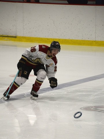 Liam Blackburn with the West Kelowna Warriors takes a ring pass during warmup at the Shutout Sports Challenge Cup Sunday.
