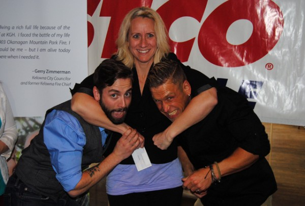 Photo: Wayne Moore - Castanet Kelley Taylor with the Kelowna Family Y puts a headlock on pro wrestlers Scotty Mac (l) and Collin Cutler