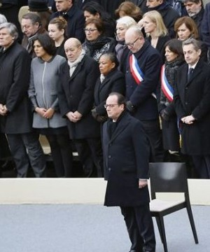 A subdued France paid homage Friday to those killed two weeks ago in the attacks that gripped Paris in fear and mourning.