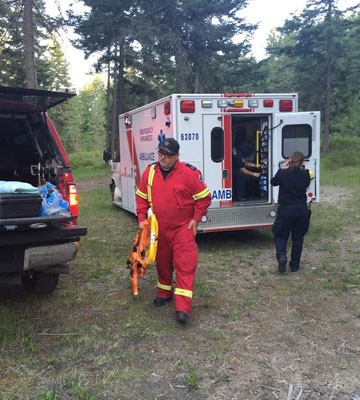 Emergency crews prepare to assist in the rescue of a woman in Mill Creek Regional Park Monday evening.