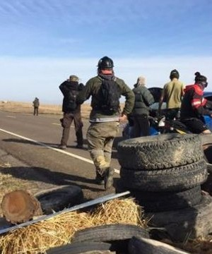 Law enforcement officers dressed in riot gear and firing bean bags and pepper spray evicted protesters Thursday from private land in the path of the Dakota Access oil pipeline.