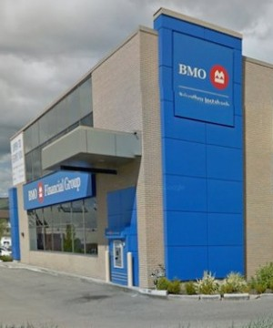Bank of Montreal raised its dividend Tuesday as it reported a fourth-quarter profit of $1.35 billion, up a 11 per cent from a year ago.