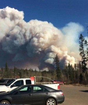 An out-of-control wildfire has sparked a mandatory evacuation order for two areas just south of Fort McMurray.