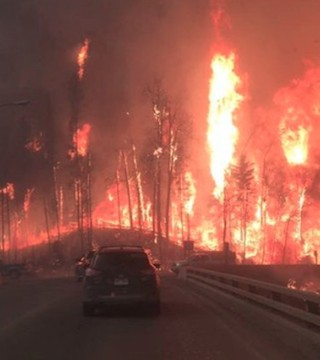 Photos of wildfire's fury as residents of Fort McMurray flee the flames.