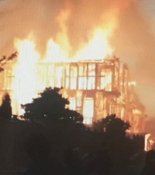 A massive construction site fire has forced four families from their homes at a townhouse development near Victoria.