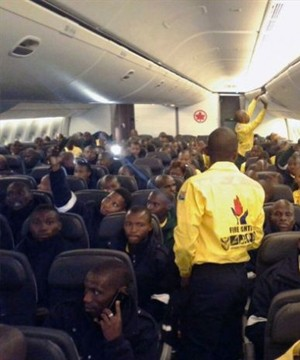 Three hundred South African firefighters have arrived in Alberta to help battle wildfires raging in the province's north.