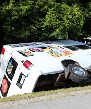 Surrey RCMP are investigating after the driver of an ice-cream truck allegedly mowed down several garbage cans before driving into a ditch Thursday afternoon.