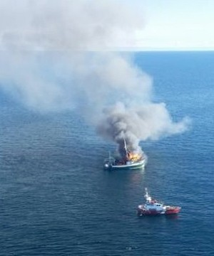 Four fishermen are safe after a rescue at sea from a burning boat about 50 kilometres off the coast of Newfoundland.
