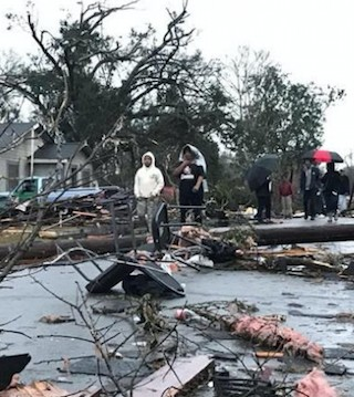 A tornado killed four people and flattened scores of homes Saturday.