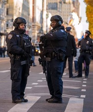 The Macy's Thanksgiving Day Parade marched, rolled and soared in traditional style Thursday as police went all-out to secure it in a year marked by attacks on outdoor gathering spots.