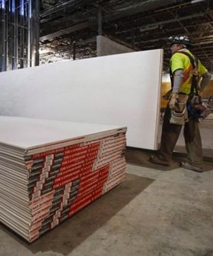 Canada will slash anti-dumping duties on U.S. drywall imports after a trade panel ruled that maintaining levies imposed last fall would harm consumers and businesses.