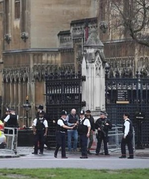 Britain's Parliament was locked down Wednesday after an attacker stabbed an officer and was then shot by police.