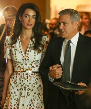 George Clooney and his wife Amal are reluctant to name their children before they meet them.