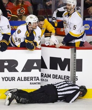NHL linesman Don Henderson is suing defenceman Dennis Wideman and the Calgary Flames for $10.25 million.