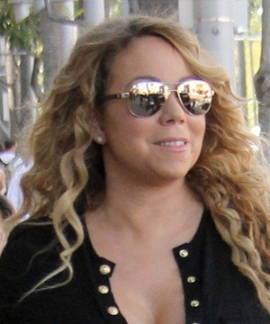 Mariah Carey was once so poor she couldn't afford enough food to eat and now that she's rich, she still suffers from crippling insecurity.
