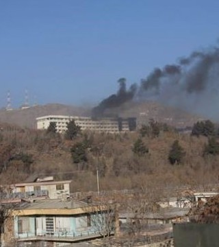18 killed included 14 foreigners and a telecommunications official from the western Farah province.