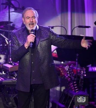 Neil Diamond is retiring from touring after he says he was diagnosed with Parkinson's disease.