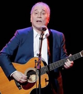 Paul Simon ended his final concert tour under a moonlit sky on home turf Saturday,in Queens, N.Y.