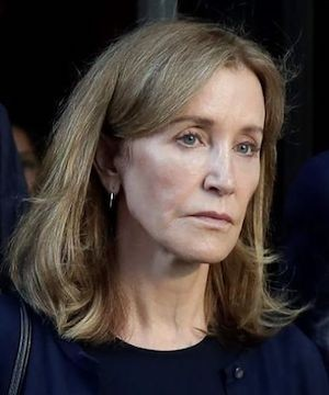 Felicity Huffman reports to California jail to serve sentence in college admissions scandal.