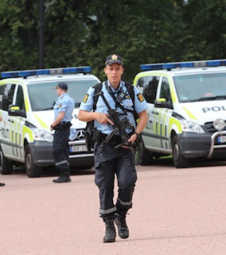 Oslo police open fire on man who reportedly drove into crowd.