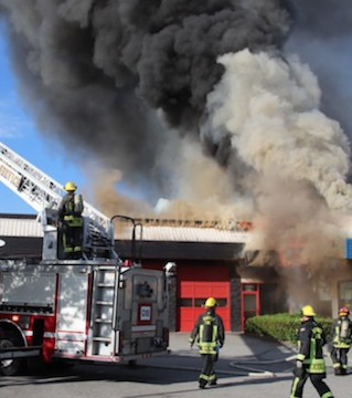 Fire gutted a strip mall and closed down part of the Fraser Highway in Surrey, Sunday.
