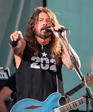 Foo Fighters frontman Dave Grohl invites crowd-surfing wheelchair user up on stage.