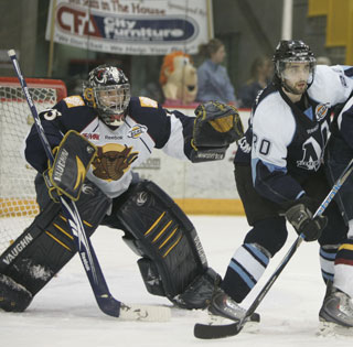 Vipers net minder Graeme Gordon with Darick Ste-Marie ready for a rebound during Vernon's 5-0 series clinching win in Quesnel. (Photo: Roger Tepper)
