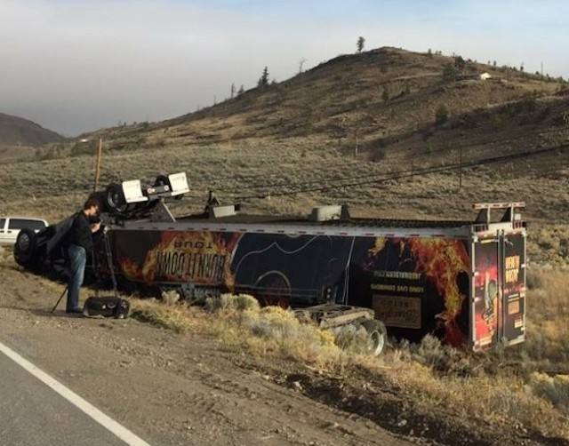 Jason Aldean's tour semi-truck flipped over on the side of the road