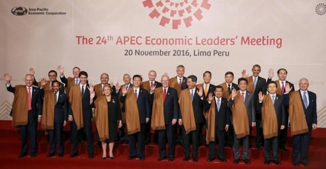 APEC leaders vow to fight protectionism, look to China on trade