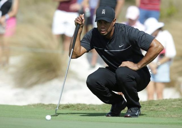 Watch as Tiger Woods hits his first competitive shot of the year