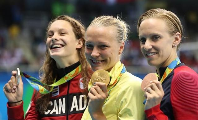 Dana Vollmer wins a Bronze in 100 Fly