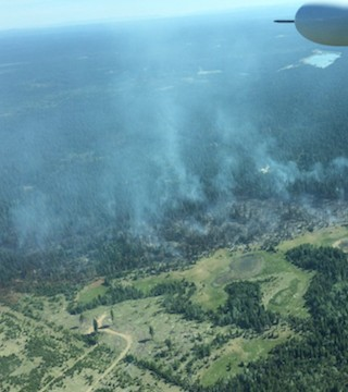 Forestry crews continued to battle fire near 100 Mile House on Sunday.