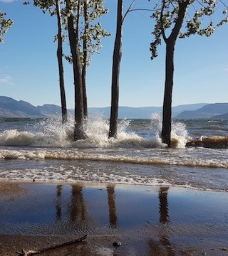 Sandbags and flood barriers to come down at some Kelowna beaches in time for long weekend.
