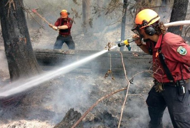 Elephant Hill wildfire stabilizing, winds moving fire away from Clinton