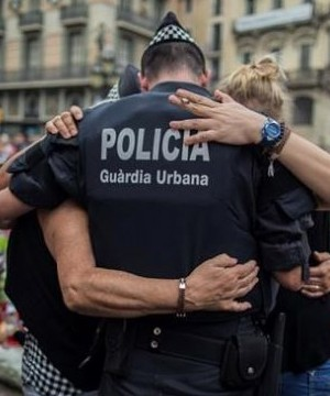 Four alleged members of a terror cell accused of killing 15 people in attacks in Barcelona and a nearby resort appeared in court Tuesday.