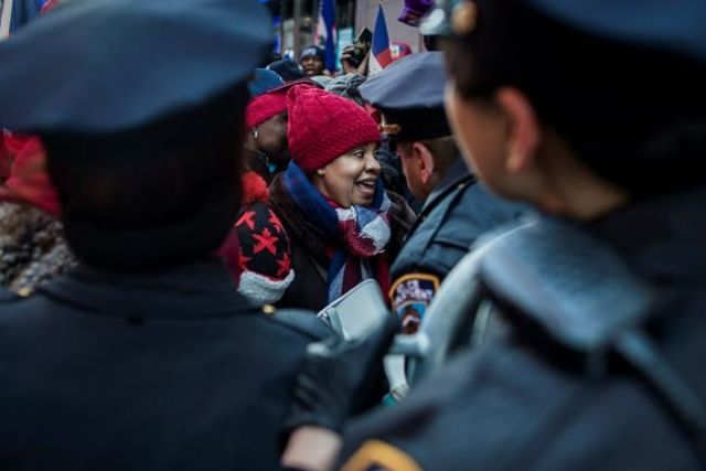Police officers disperse protesters during a rally against racism in Times Square New York