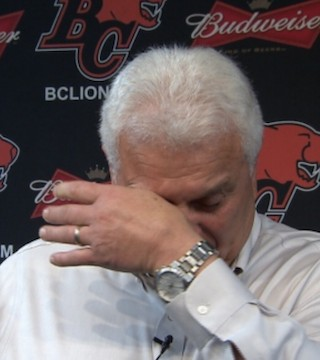 Wally Buono chokes up as he signs off at his farewell press conference.