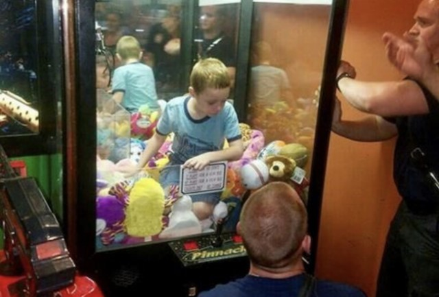 Boy gets stuck in arcade machine after trying to grab stuffed toy