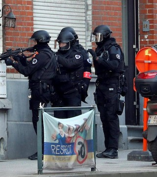 Belgian police seal part of capital in major security operation.