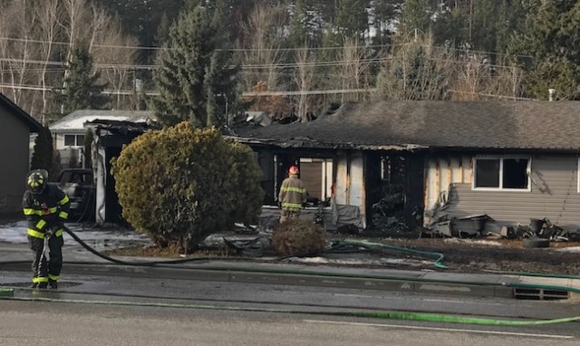 Woman dies after running back in to Kelowna house fire