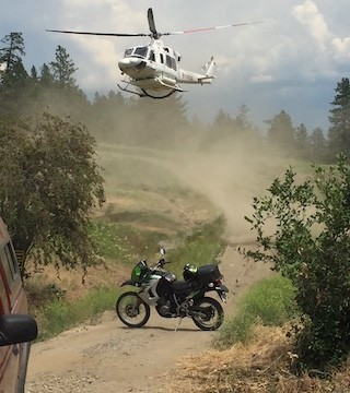 Helicopter flies in technician to site of dirtbike crash near Bear Creek.